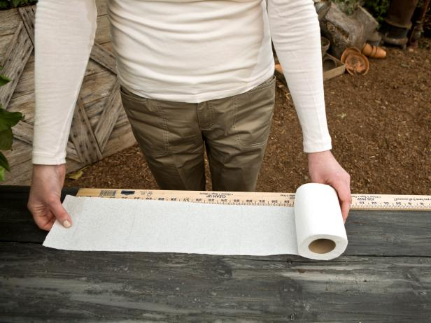 Start by measuring out a length of toilet paper.