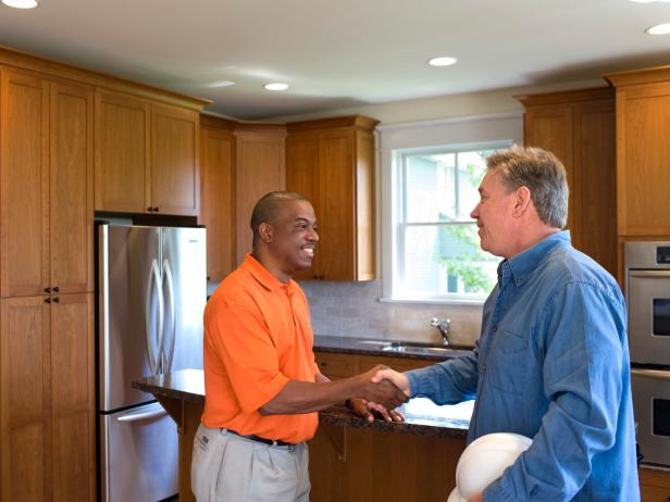 Contractor and Homeowner Shake Hands On Renovation