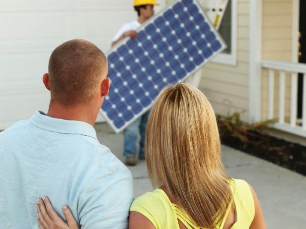 iStock-8999100_homeowners-installing-solar-panels-crop_s4x3