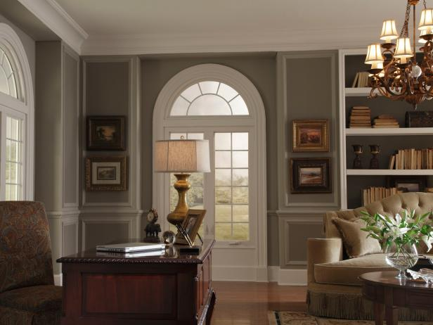 Home Office With Arched Windows, Oil Paintings, Wood Desk