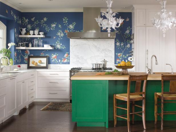 Kitchen With White Cabinets, Blue Wallpaper and Green Island
