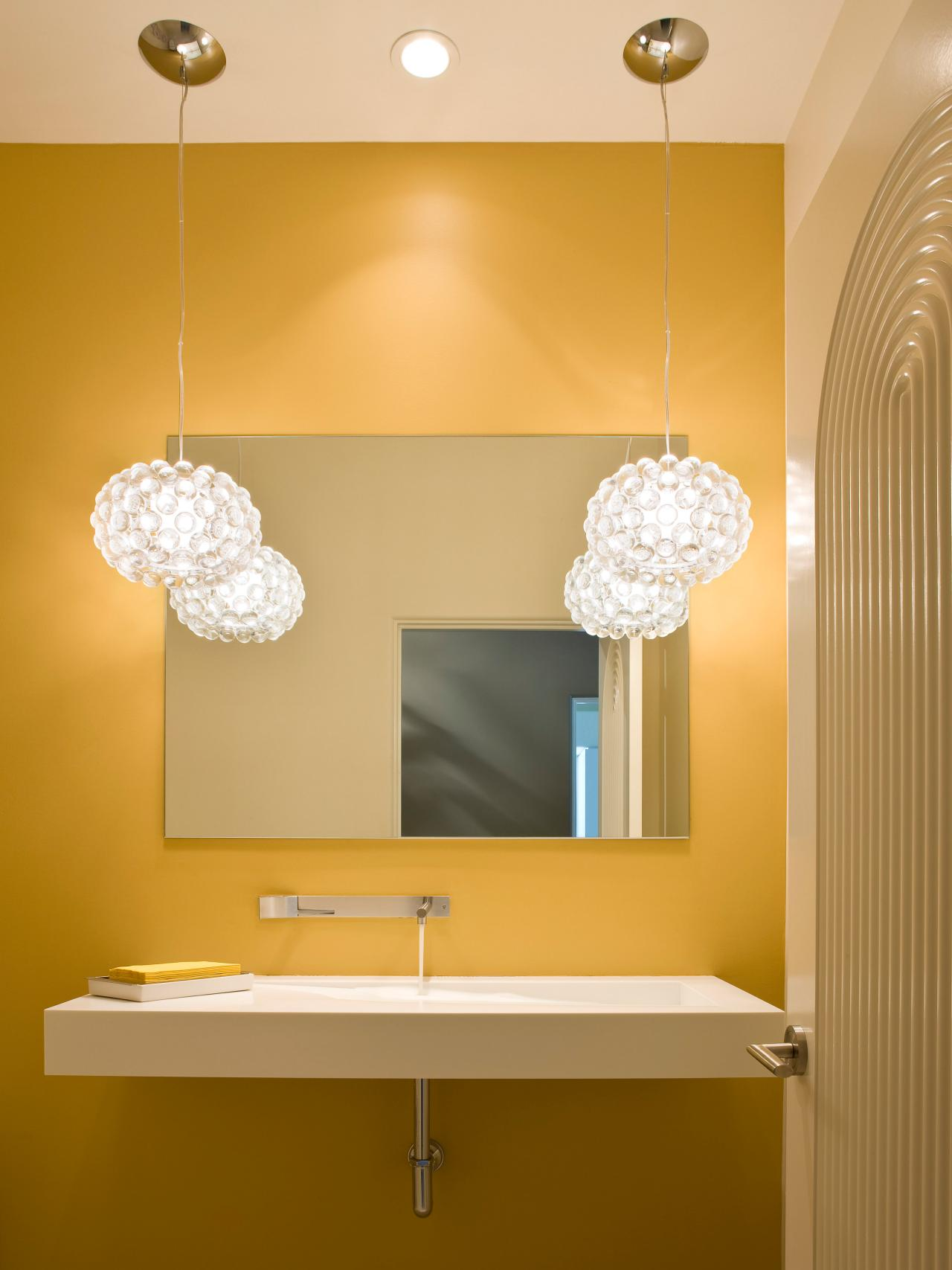 Eye Catching Lighting. Sleek Yellow Bathroom