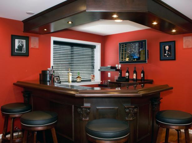 Red Basement Bar With Recessed Lighting In Custom Woodwork