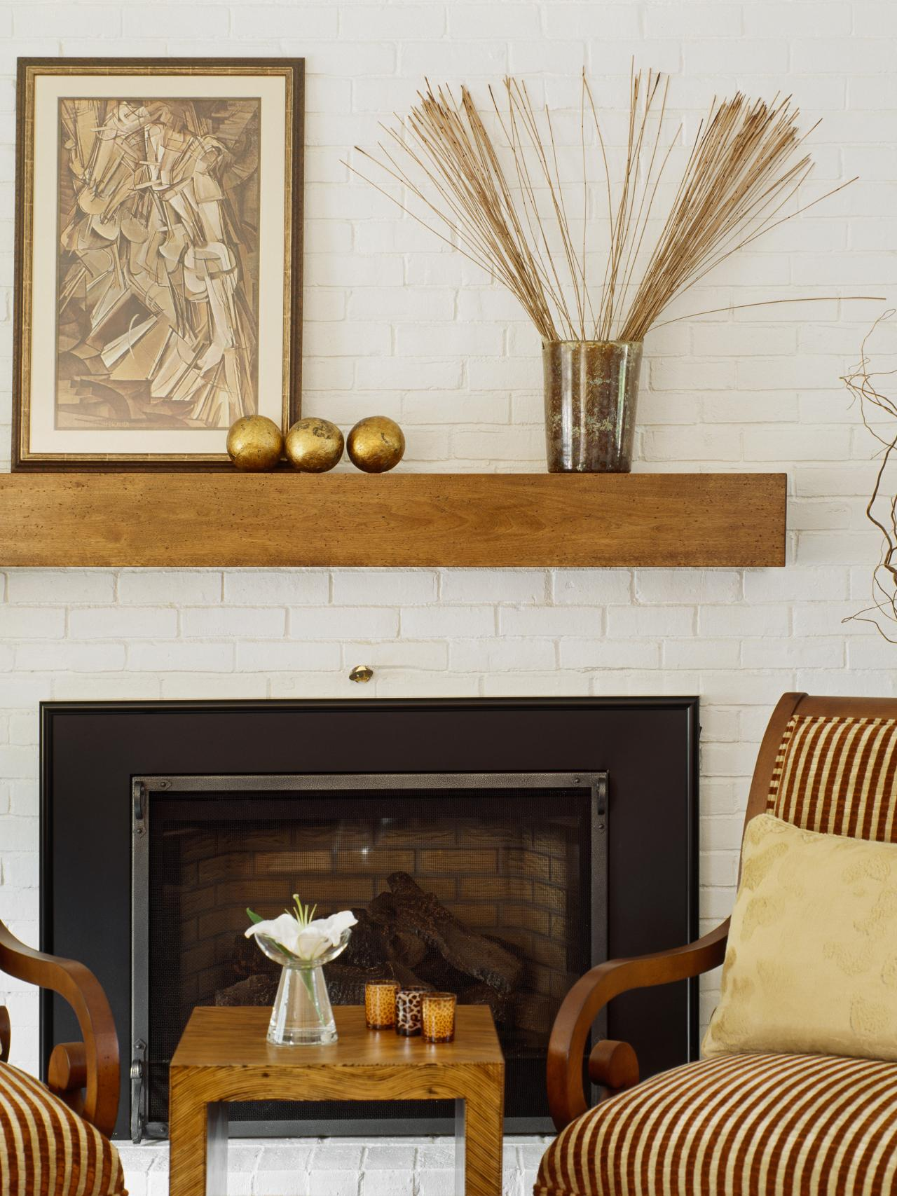 The design experts at HGTV.com share their tips on how to decorate your fireplace and mantel this summer.