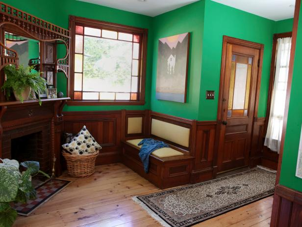 Kelly-Green Craftsman Entry With Light Hardwood Floors & Dark Woodwork