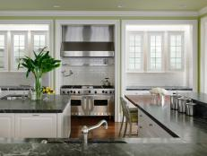 Double Kitchen Islands Topped With Waterfall Countertops