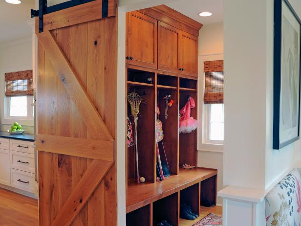 Rustic Mudroom With Wood Cabinets