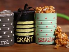 Need a budget-friendly gift idea for a group? These personalized DIY snack tins filled with delicious homemade salted caramel popcorn are both thoughtful and easy to make. No chance they'll re-gift!