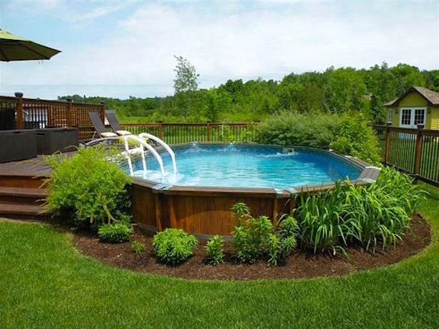 17 ways to add style to an above ground pool hgtv 39 s for Gartenpool oval