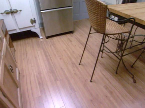 How To Install Laminate Flooring HGTV - What do i put under laminate flooring