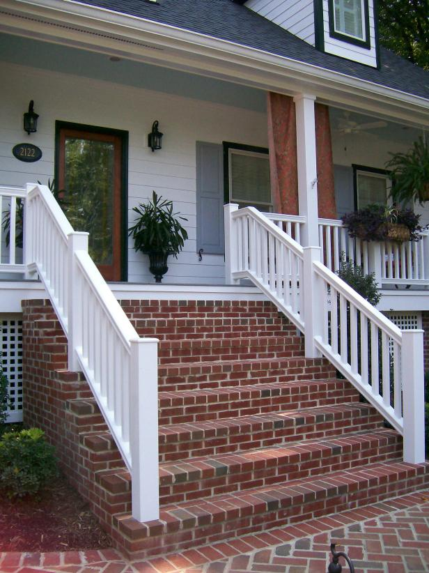 Country Porch With Brick Steps, Blue Ceiling and White Railing
