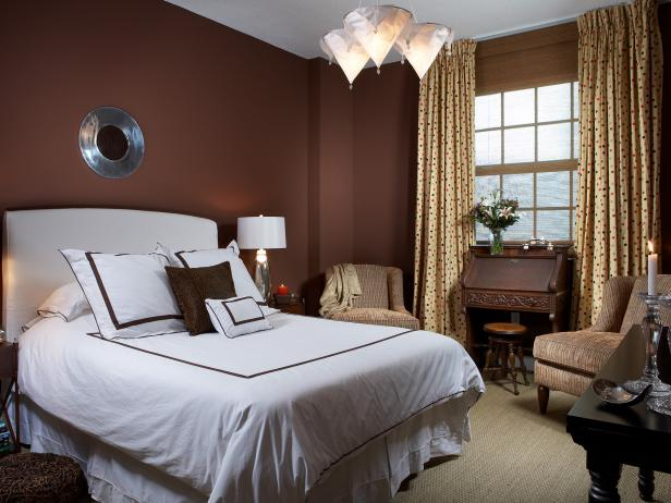 Brown Bedroom With White Bed and Conical Pendant Lights
