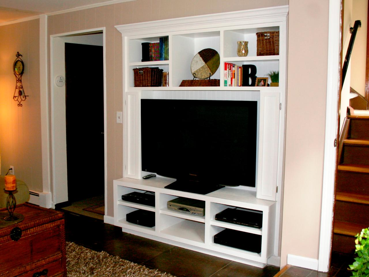 Turn a closet into a built in entertainment center hgtv for Gun room design ideas for houses