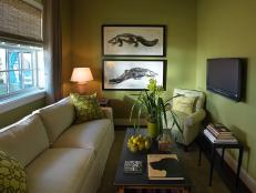 Gold wall color paired with animal prints and upcycled furnishings tell an eco-friendly story in this laid-back gathering space.
