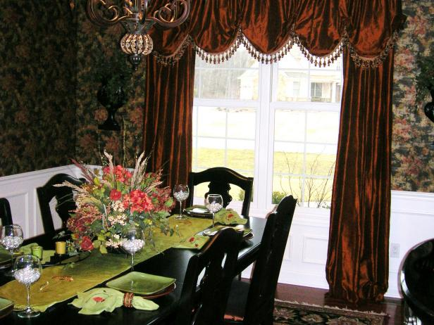 Dining Room With Floral Wallpaper and Red Velvet Drapes
