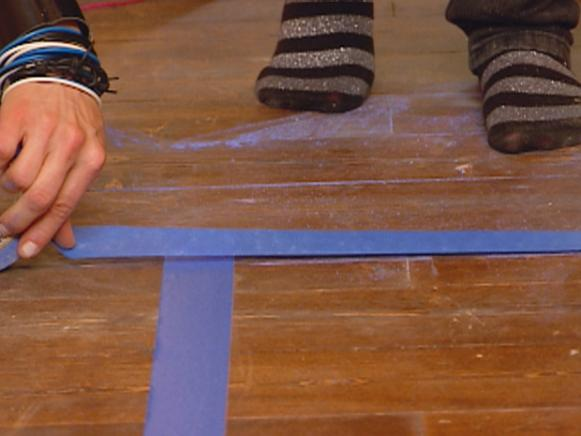 Placing Painter's Tape for a Faux Painted Rug