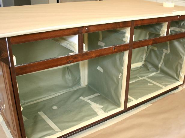 A kitchen island, with the interior protected with masking paper.