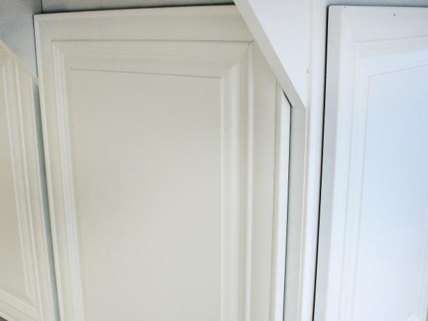 A kitchen cabinet door front with primer paint applied.