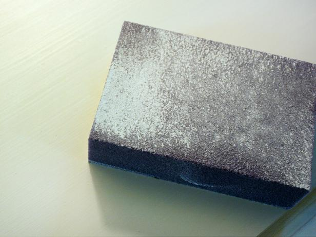 Gray Sanding Pad With White Dust