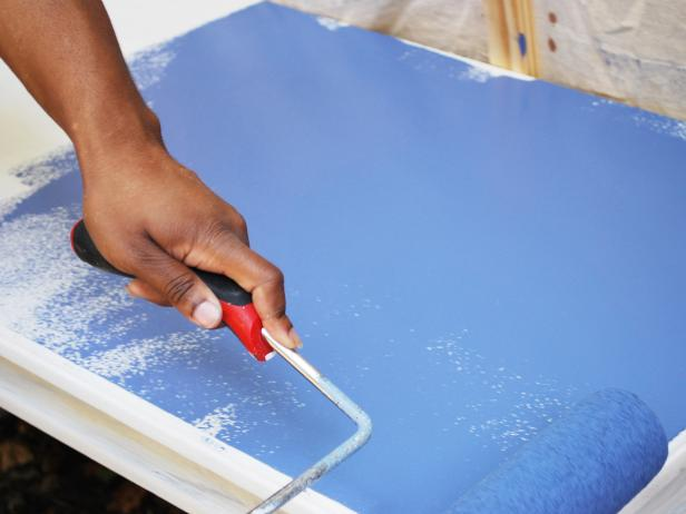 Use a paint roller to apply two even coats of paint to your table. Let it dry. Replace the paint pan with a new liner, then pour floor sealer into the new liner. Use a paint roller to apply a single coat. Tip: Keep the paint brush nearby to brush out any air bubbles.