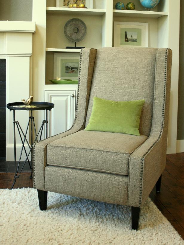 Add nail head trim to furniture hgtv transitional taupe upholstered chair with nailhead trim solutioingenieria Image collections