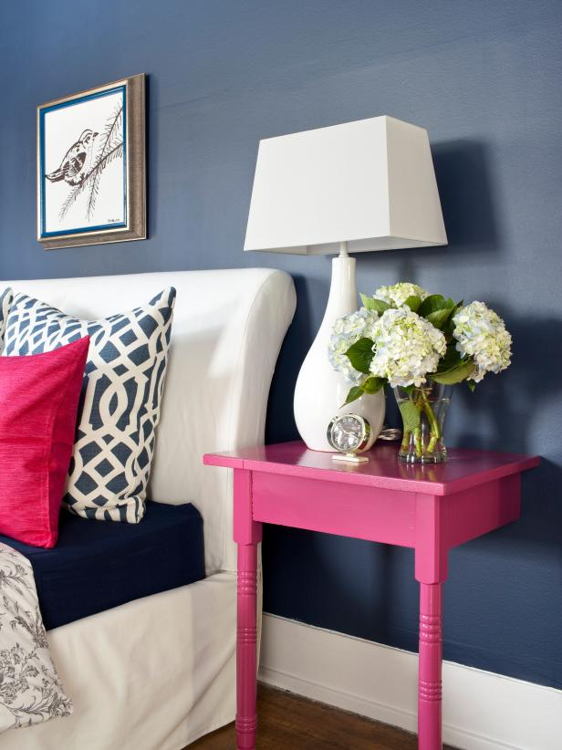 Navy Blue Bedroom With Stylish Pink Nightstand