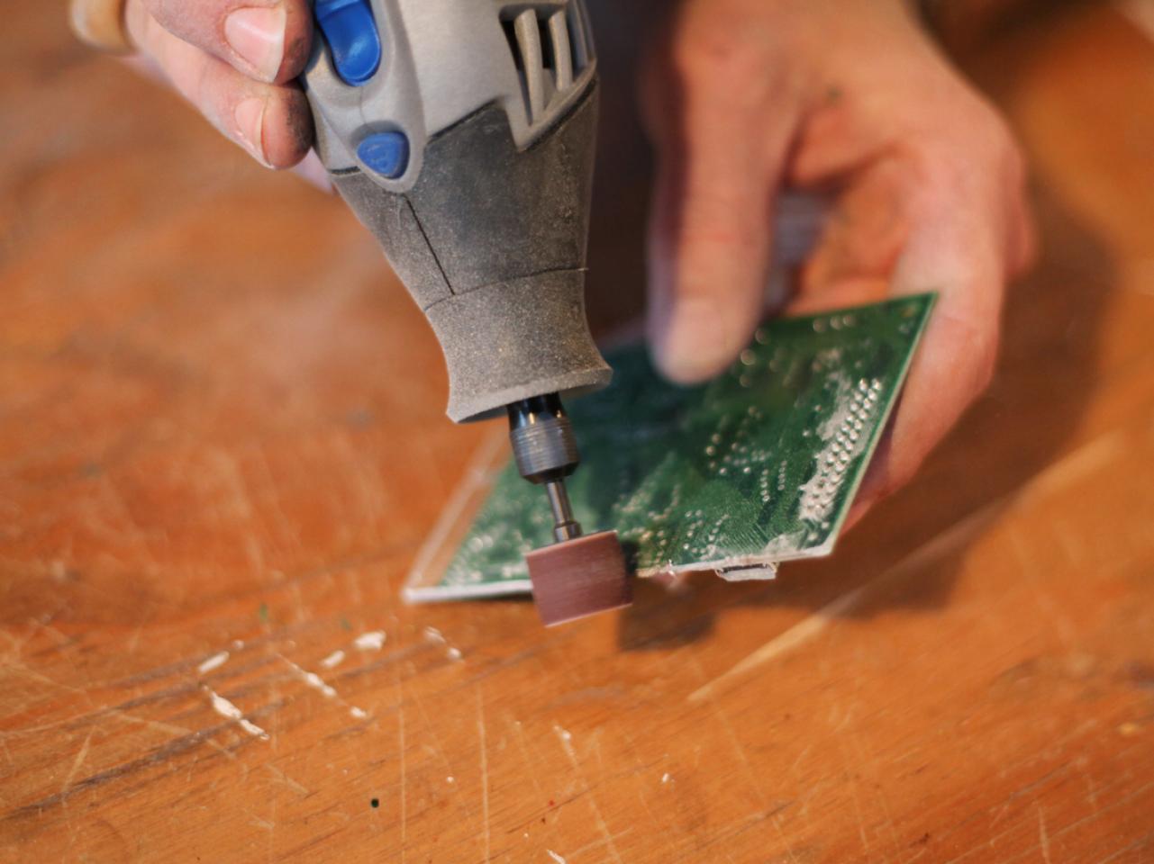 computer circuit board belt buckle hgtvsanding edges of circuit board with dremel tool