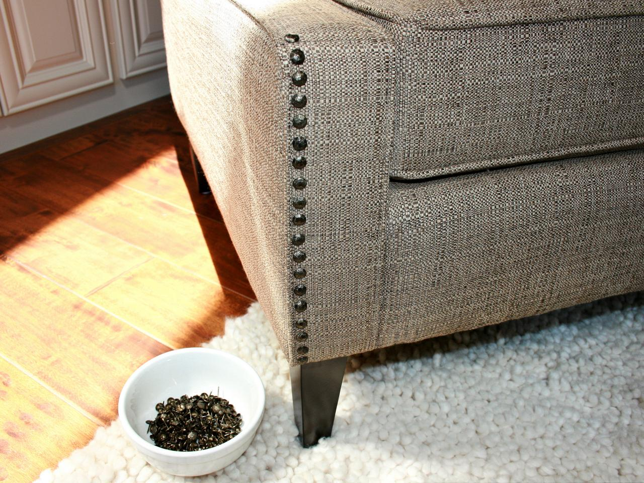 Add nail head trim to furniture hgtv continue line of nail head trim on chair solutioingenieria