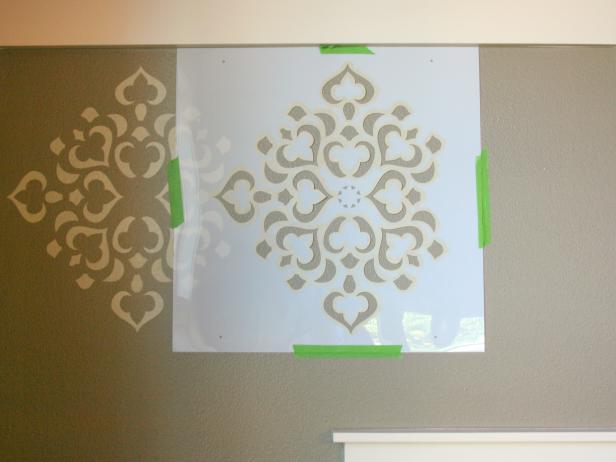 Stencil Taped Beside Painted Pattern on Gray Wall