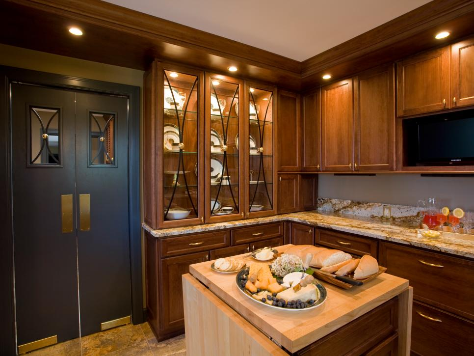 Traditional Kitchen With China Cabinet and Butcher Block Island