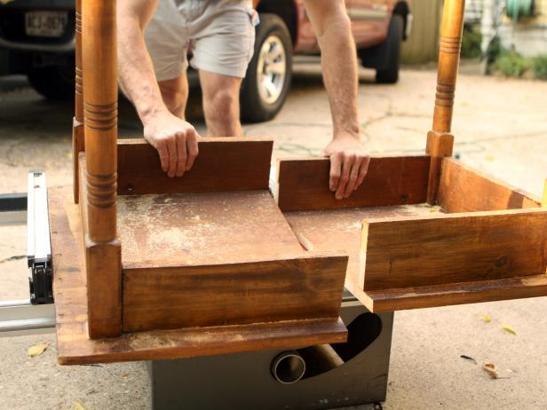 Next, use the table saw to cut the table in half. Each half will become a nightstand with the legless end supported by a wooden cleat attached to the wall.