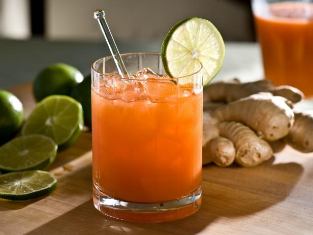 Orange Cocktail With Lime Garnish