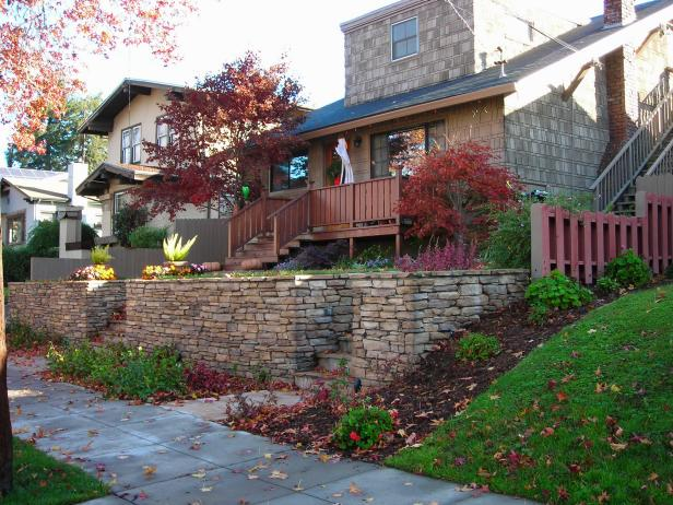 Front Yard With Colorful Landscaping and Gray Stacked-Stone Wall