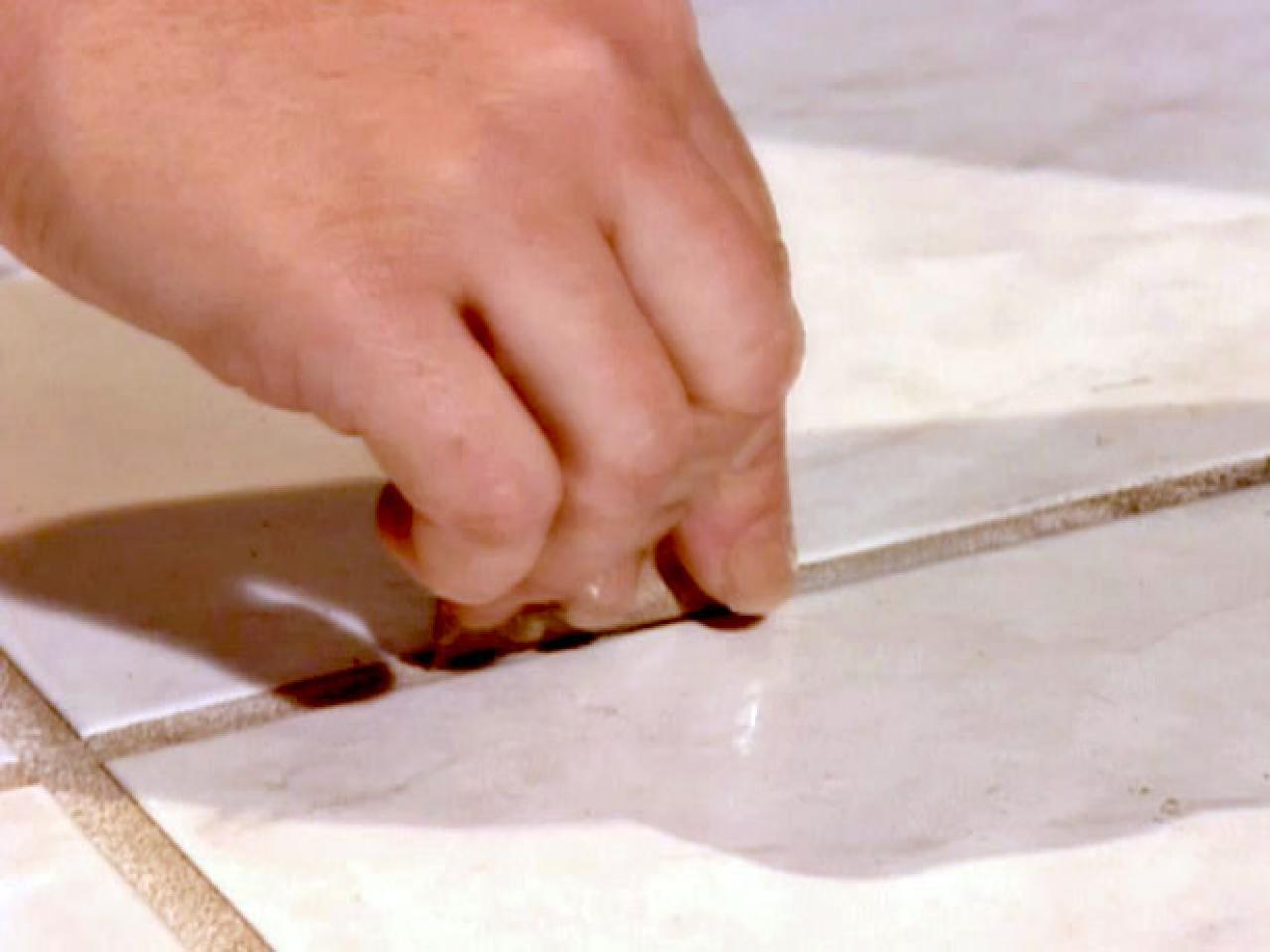 Easy cheap and green cleaning tips for floors hgtv clean tile floor grout with sandpaper dailygadgetfo Images