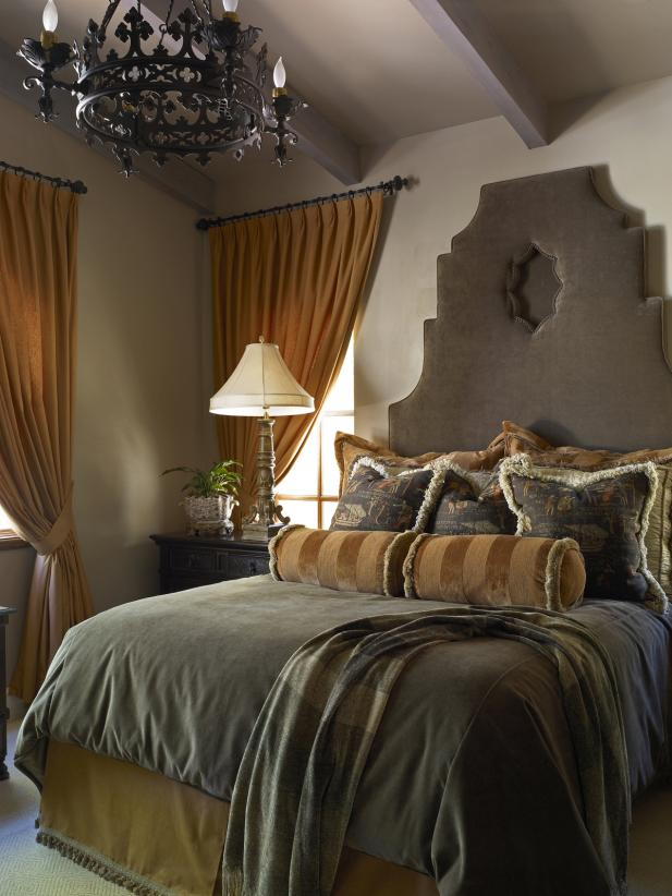Gray and Beige Guest Bedroom With Iron Chandelier and Custom Headboard