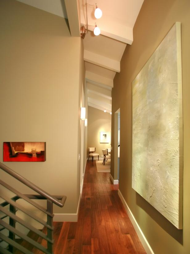Contemporary Hallway With Hardwood Floors and Wall Art