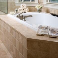 Tumbled Tile Bathtub Surround In Neutral Bathroom