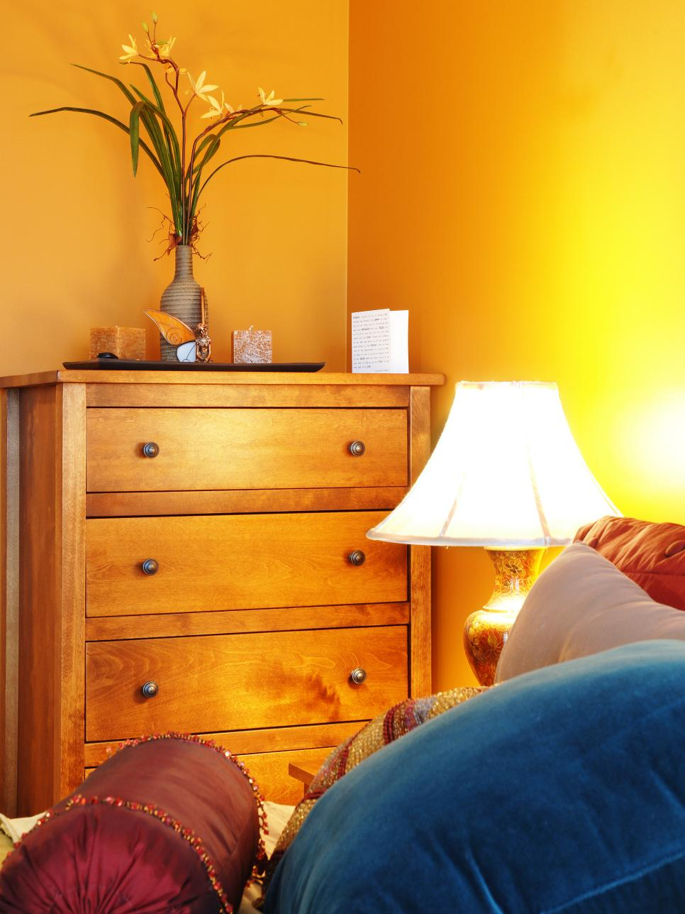 Yellow Bedroom With Traditional Light Hardwood Dresser