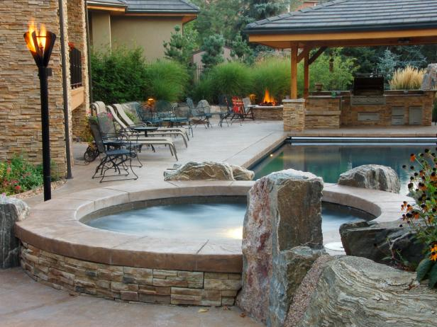Stone Spa and Outdoor Kitchen Area | HGTV