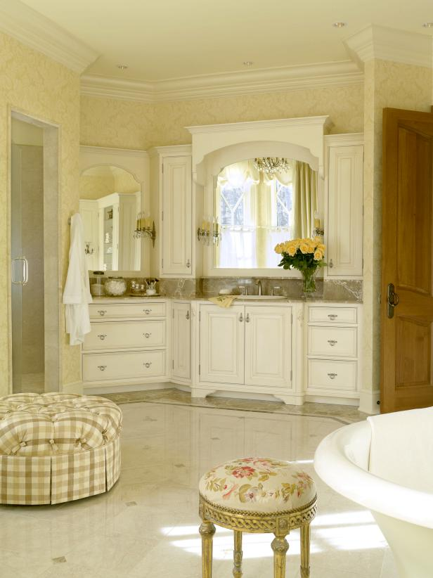 French Country Bathroom With Distressed White Vanity Cabinets