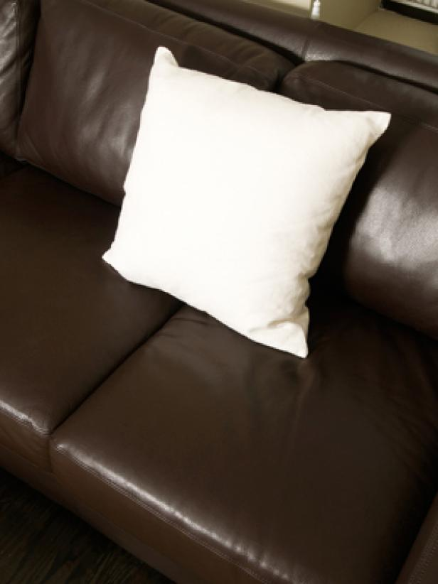 leather sofa with white pillow