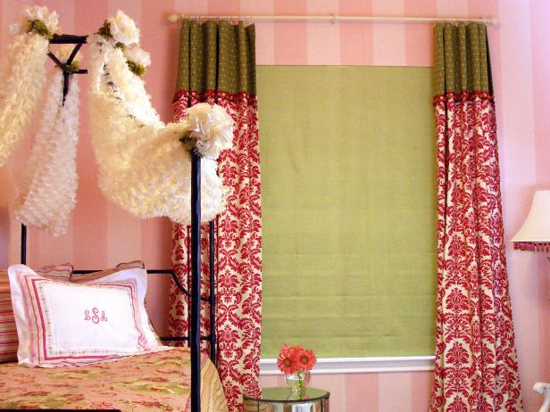 Eclectic Girl's Bedroom With Striped Wallpaper and Canopy Bed
