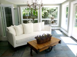 White Sofa and Chandelier in Sunroom