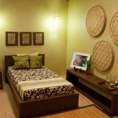 Light Green Bedroom With Rich Wood Furniture