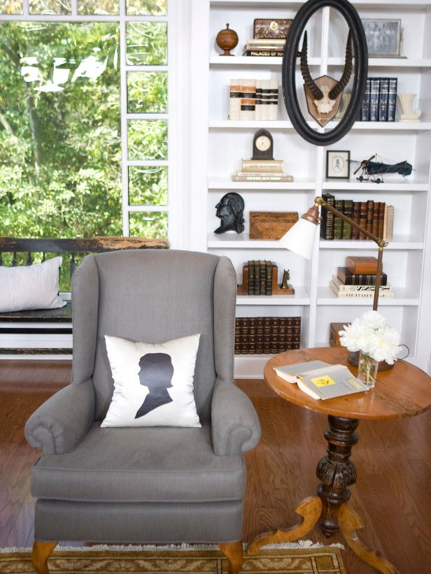 Sitting Area With Gray Wingback Chair and White Built-In Bookshelf