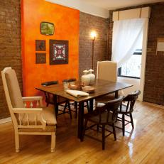 Contemporary Brick Dining Room With Orange Accent Wall