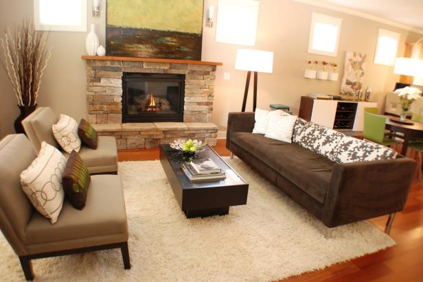 Neutral Modern Living Room With Stone Fireplace and Gray Furnishings