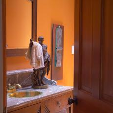 Grecian Statue Towel Holder in Orange Bathroom