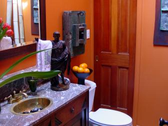 Wood and Marble Vanity in Burnt Orange Grecian Bathroom