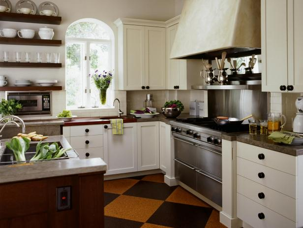 Country Kitchen With White Cabinets and Dark Wood Floating Shelves